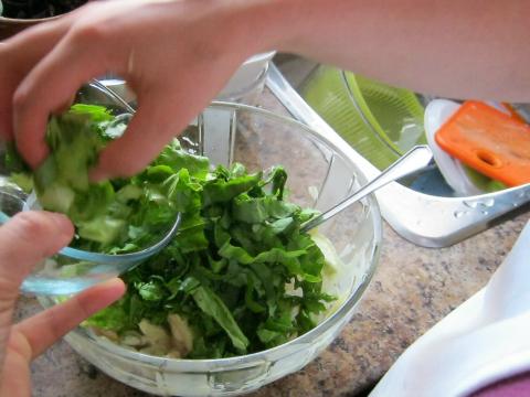 Adding Fresh Chopped Lettuce
