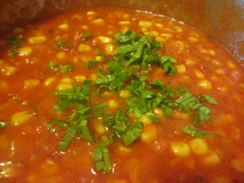 Adding Parsley to Corn and Tomato Sauce