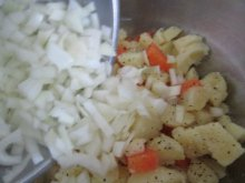 Adding the Onions to the Veggies